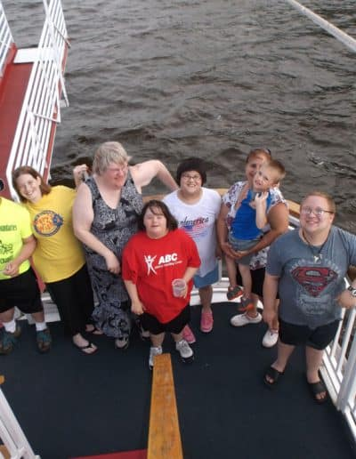 A group poses for a photo on the La Crosse Queen