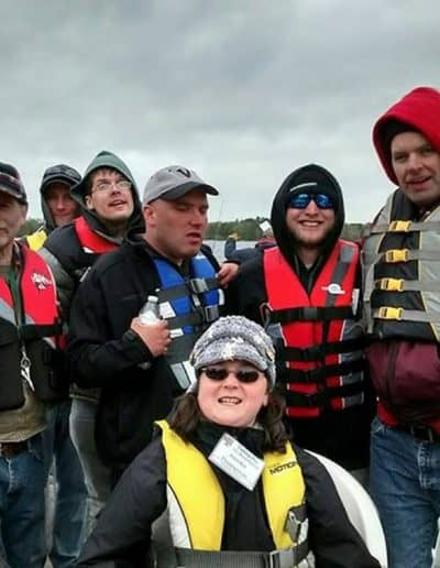 A day on the river - a group gathers on a pontoon boat for a photo