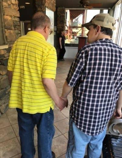Friends walk hand in hand